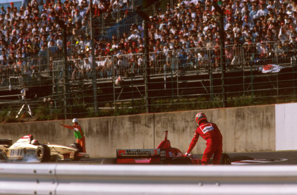 Suzuka, Japan.11-13 October 1996.Eddie Irvine (Ferrari F310) exits the race after a collision with Gerhard Berger at Casio Triangle Chicane.Ref-96 JAP 21.World Copyright - LAT Photographic