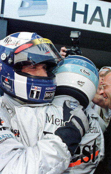 1998 Australian Grand Prix.Albert Park, Melbourne, Australia.6-8 March 1998.Mika Hakkinen and David Coulthard (McLaren Mercedes-Benz) after qualifying on the front row.World Copyright - Tee/LAT Photographic