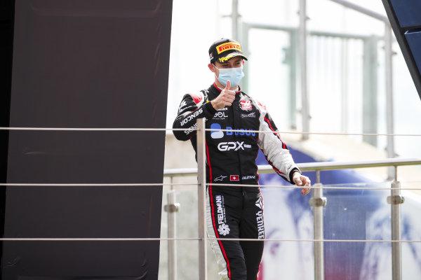 Louis Deletraz (CHE, CHAROUZ RACING SYSTEM) celebrates on the podium