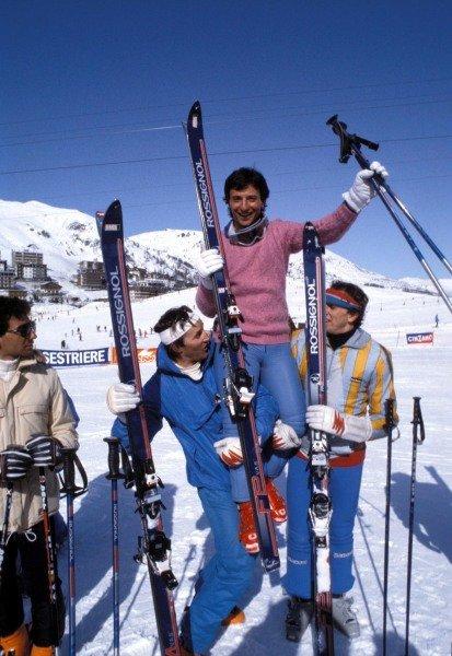 Kitzbuhel, Austria. 1983. Riccardo Patrese in hoisted into the air by fellow skiers on the slopes. Michele Alboreto looks on