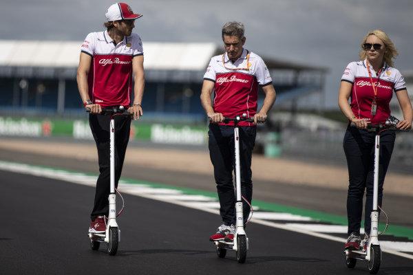 Antonio Giovinazzi, Alfa Romeo Racing walks the track on a scooter
