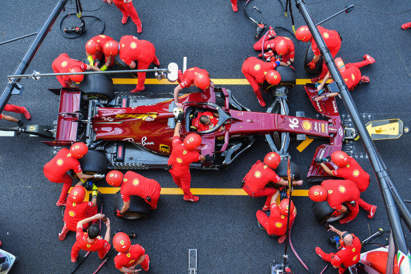 Ferrari mechanics practice a pitstop