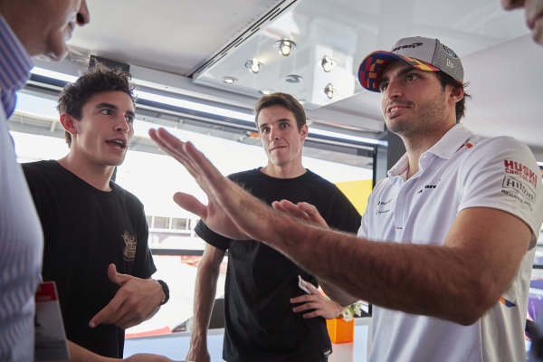 Moto GP riders Alex and Marc Marquez with Carlos Sainz Jr, McLaren and his father