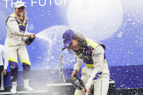 Beitske Visser (NLD) and Jamie Chadwick (GBR) celebrate on the podium with the champagne