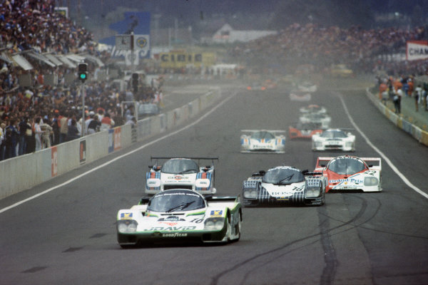 Le Mans, France. 18-19 June 1983.John Fitzpatrick/Guy Edwards/Rupert Keegan (Porsche 956), 5th position, leads at the start of the race, action. World Copyright: LAT Photographic.Ref:  83LM10