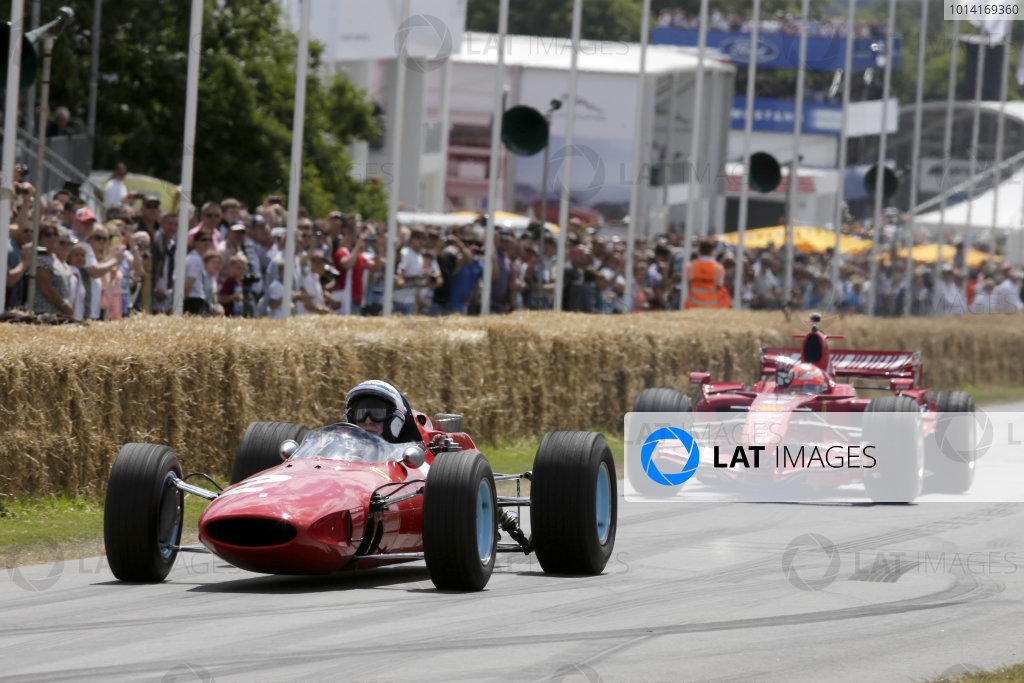 2014 Goodwood Festival of Speed. Goodwood Estate, West Sussex, England. 26th - 29th June 2014. 1964 and 2007 Ferrari World Champions, John Surtees and Kimi Raikkonen. World Copyright: Gary Hawkins/LAT Photographic.