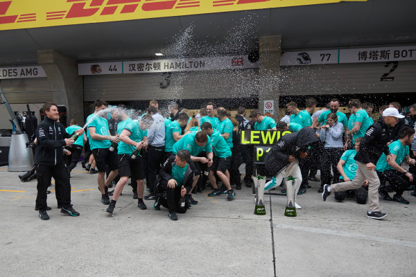 Shanghai International Circuit, Shanghai, China.  Sunday 9 April 2017. Lewis Hamilton, Mercedes AMG, 1st Position, and Valtteri Bottas, Mercedes AMG, celebrate with the Mercedes AMG team. World Copyright: Steve Etherington/LAT Images ref: Digital Image SNE28629