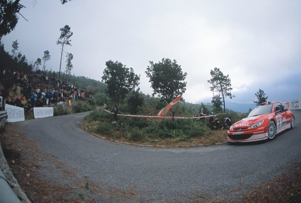 2003 World Rally ChampionshipRally of San Remo, Italy. 2nd - 5th October 2003.Marcus Gronholm / Timo Rautiainen, Peugoet 206 WRC. Approaching Hairpin. Fisheye. Action.World Copyright: McKLEIN/LATref: 35mm Image WRCSANREMO18 jpg