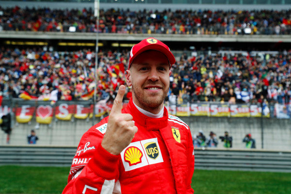 Sebastian Vettel, Ferrari, celebrates taking pole position.