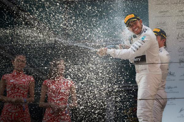 Shanghai International Circuit, Shanghai, China. Sunday 12 April 2015. Lewis Hamilton, Mercedes AMG, 1st Position, sprays the victory Champagne from the podium. World Copyright: Steve Etherington/LAT Photographic. ref: Digital Image SNE20347