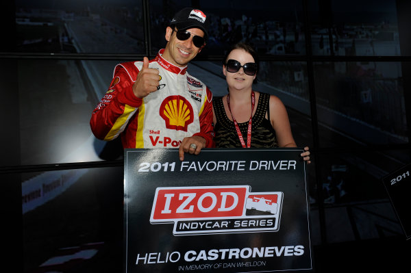 23-25 March, 2012, St Petersburg, Florida USAHelio Castroneves is presented with the 2011 IndyCar Favorite Driver award by Dan Wheldon's sister Holly Wheldon(c)2012, Scott LePageLAT Photo USA
