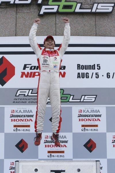 2006 Formula Nippon Championship Autopolis, Japan. 5th - 6th August 2006 Race podium - winner Tsugio Matsuda (mobilecast IMPUL) 1st position. World Copyright: Yasushi Ishihara / LAT Photographic ref: Digital Image 2006FN_R5_008