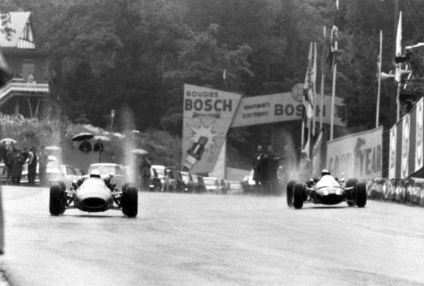 1966 Belgian Grand Prix.Spa-Francorchamps, Belgium. 12 June 1966.Guy Ligier, Cooper T81-Maserati, not classified, leads Jochen Rindt, Cooper T81-Maserati, 2nd position, action.World Copyright: LAT PhotographicRef: Motor b&w print