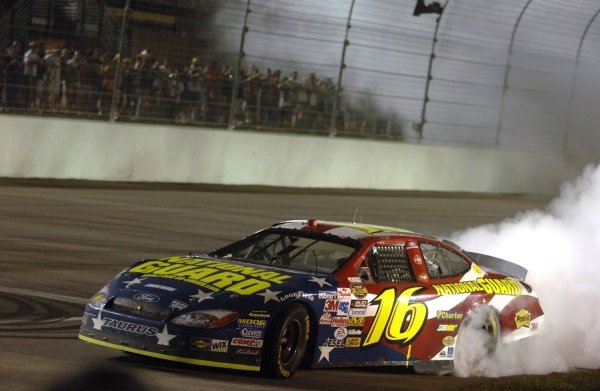 Greg Biffle (USA) celebrates after taking the win. NASCAR Nextel Cup, Rd36, Homestead-Miami Speedway, Florida, USA, 20 November 2005. DIGITAL IMAGE