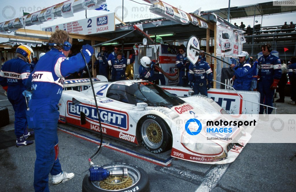 Davy Jones (USA) left, waits for his team mate to leave the pits in the TWR Jaguar XJR-12D after a pitstop. IMSA GTP Championship, Rd1, Daytona 24 Hours, Daytona Beach, Florida, USA. 2 January 1992. BEST IMAGE
