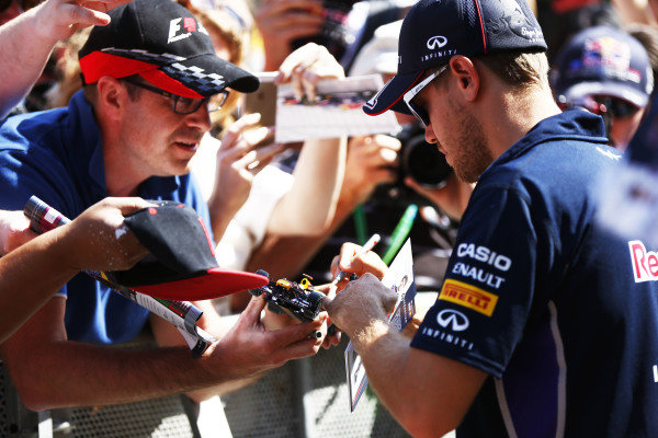 Circuit de Catalunya, Barcelona, Spain. Thursday 8 May 2014. Sebastian Vettel, Red Bull Racing, signs autographs for fans. World Copyright: Andy Hone/LAT Photographic. ref: Digital Image _ONY7663