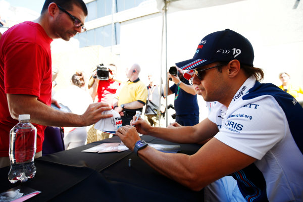 Circuit Gilles Villeneuve, Montreal, Canada. Thursday 08 June 2017. Lance Stroll, Williams Martini Racing, and Felipe Massa, Williams Martini Racing, sign autographs for fans. World Copyright: Andy Hone/LAT Images ref: Digital Image _ONZ9910