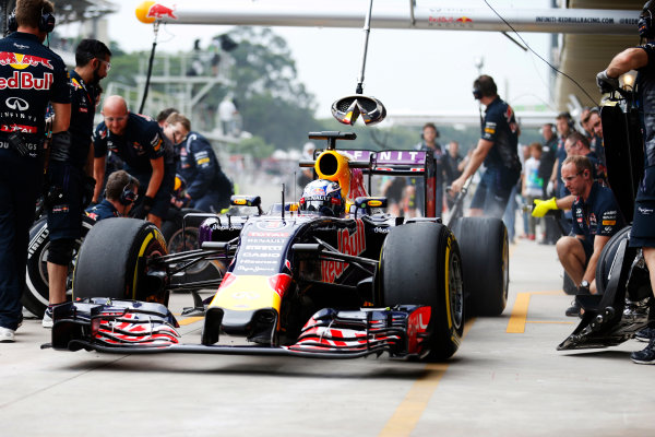 Interlagos, Sao Paulo, Brazil. Friday 13 November 2015. Daniel Ricciardo, Red Bull Racing RB11 Renault, leaves the pits after a stop during practice. World Copyright: Glenn Dunbar/LAT Photographic ref: Digital Image _89P4420