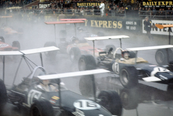 1969 International Trophy.  Silverstone, England. 30th March 1969.  Piers Courage, Brabham BT26 Ford, Jo Siffert, Lotus 49B Ford, and Graham Hill, Lotus 49B Ford, leave the grid in a cloud of spray.  Ref: 69IT03. World Copyright: LAT Photographic
