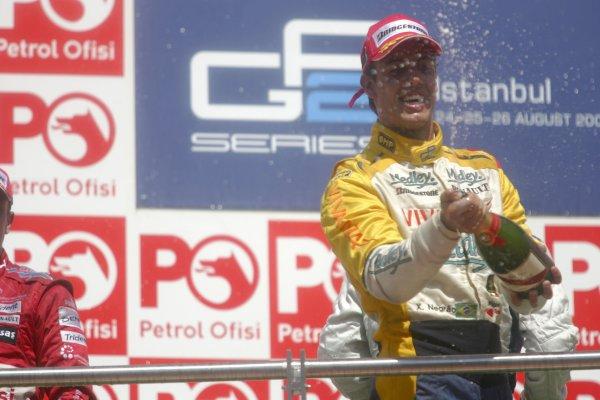 2007 GP2 Series. Round 8.Istanbul Park, Istanbul Turkey. 26th August 2007. Sunday Race.Xandi Negrao (BRA, Minardi Piquet Sports) celebrates second position on the podium. World Copyright: Charles Coates/GP2 Series Media Service.ref: Digital ImageIMG_5973