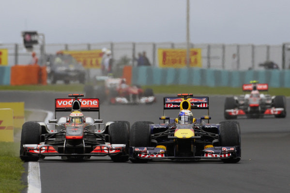 Sebastian Vettel, Red Bull RB7 Renault, battles hard with Lewis Hamilton, McLaren MP4-26 Mercedes.