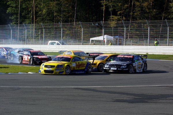2002 DTM Championship.Hockenheim, Germany. 5-6 October 2002.Christian Abt (Abt Audi TT-R) exits the Spitzkehre, with Marcel Fassler (HWA/Mercedes CLK DTM), Johnny Cecotto (Euroteam/Opel Astra V8 Coupe DTM) and Jean Alesi (HWA/Mercedes CLK DTM) all about to collide behind. World Copyright - Andre Irlmeier/LAT PhotographicSpitzkehre sequence - 1.