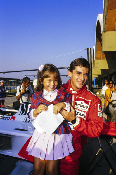 Ayrton Senna with a young fan.