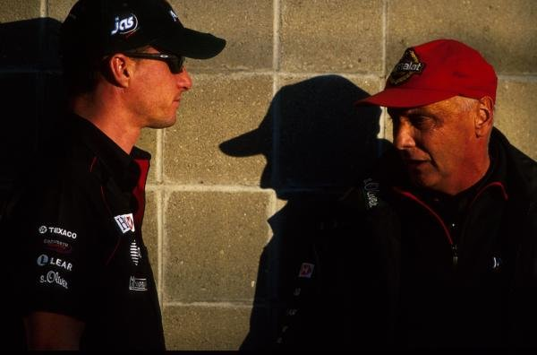 L-R: Eddie Irvine(GBR), Niki Lauda (AUT)  USA Grand Prix, Indianapolis 30 September 2001 BEST IMAGE