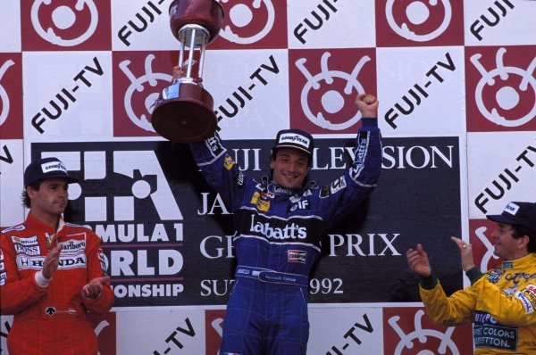 Gerhard Berger, 2nd position, Riccardo Patrese, 1st position, and Martin Brundle, 3rd position, on the podium.