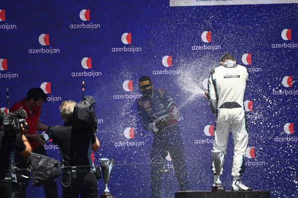 Robert Shwartzman (RUS, Prema Racing), 1st position, and Dan Ticktum (GBR, Carlin), 2nd position, spray Champagne on the podium