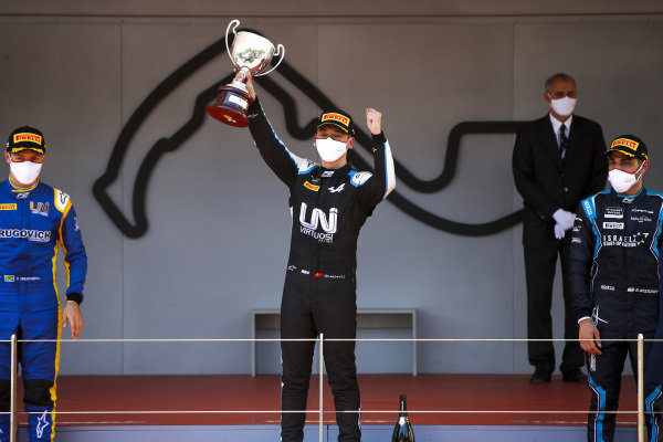 Felipe Drugovich (BRA, Uni-Virtuosi), Race winner Guanyu Zhou (CHN, Uni-Virtuosi Racing) Roy Nissany (ISR, DAMS) celebrate on the podium with the trophy