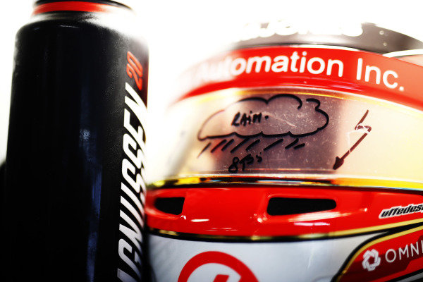 The drink bottle and helmet of Kevin Magnussen, Haas F1 Team, fitted with a rain visor