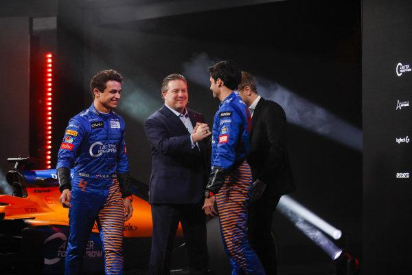 Lando Norris, McLaren, and Carlos Sainz Jr, McLaren, are greeted by Zak Brown, Executive Director, McLaren, and Andreas Seidl, Team Principal, McLaren