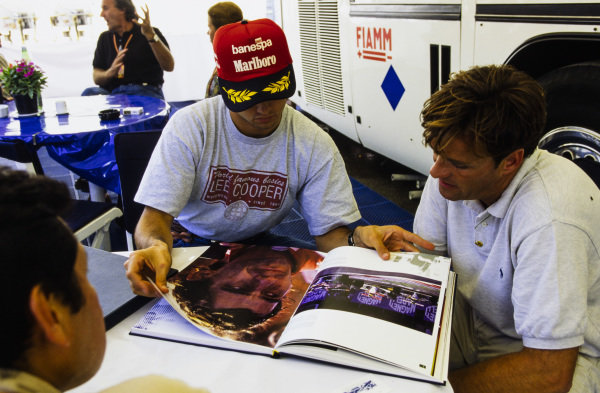 Christian Fittipaldi looks through a book of Ayrton Senna photography.