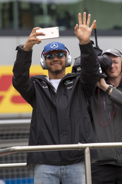 Lewis Hamilton (GBR) Mercedes AMG F1 takes a photo on the drivers parade at Formula One World Championship, Rd10, British Grand Prix, Race, Silverstone, England, Sunday 10 July 2016.