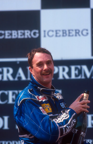 1992 San Marino Grand Prix.Imola, Italy.15-17 May 1992.Nigel Mansell (Williams Renault) 1st position on the podium. Setting a new record of winning five consecutive Grand Prix from the start of the season.Ref-92 SM 03.World Copyright - LAT Photographic