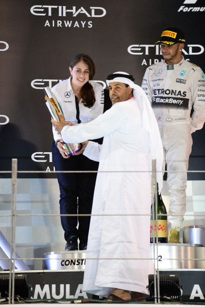 Kim Stevens (GBR) Mercedes AMG F1 Track Aerodynamicist celebrates on the podium with the Constructors trophy at Formula One World Championship, Rd19, Abu Dhabi Grand Prix, Race, Yas Marina Circuit, Abu Dhabi, UAE, Sunday 29 November 2015.