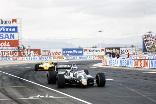 Michele Alboreto, Tyrrell 011 Ford, leads Manfred Winkelhock, ATS D5 Ford.