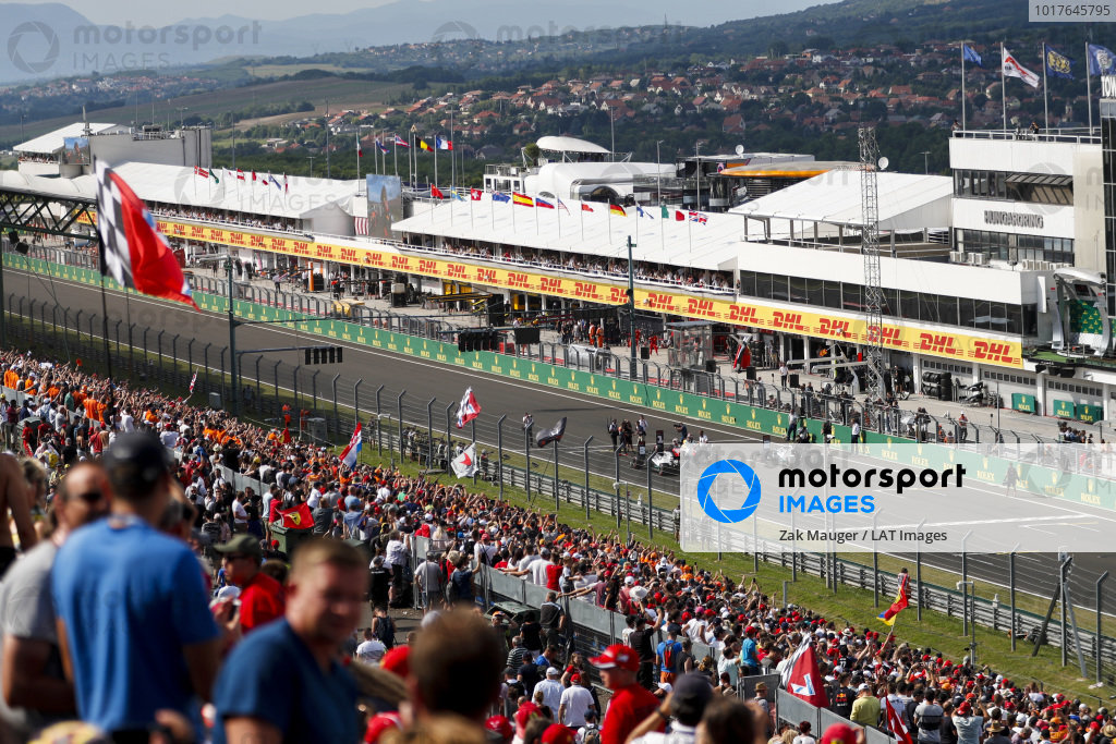 Max Verstappen, Red Bull Racing RB15, Valtteri Bottas, Mercedes AMG W10, and Lewis Hamilton, Mercedes AMG F1 W10, on the grid after Qualifying