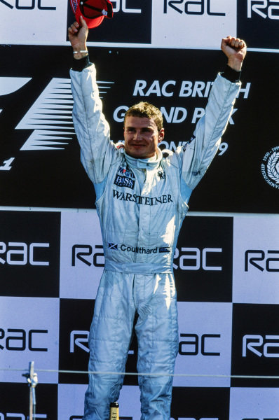 David Coulthard, 1st position, celebrates on the podium.