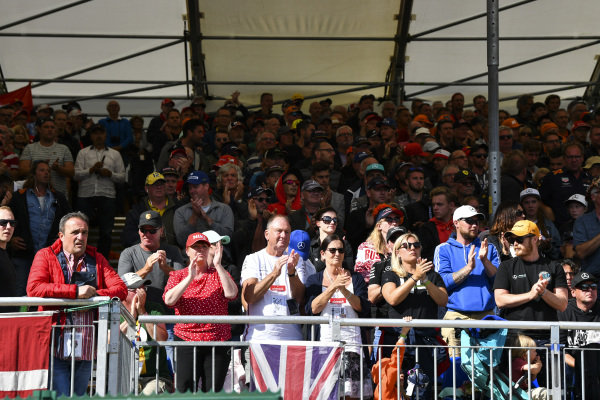 Fans conduct a standing ovation on lap 19, reflecting the race number of Anthoine Hubert in tribute