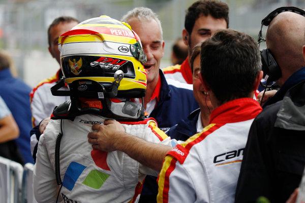 2015 GP2 Series Round 4.  Red Bull Ring, Spielberg, Austria.  Sunday 21 June 2015. Rio Haryanto (INA, Campos Racing) celebrates his win in Parc Ferme with his team. Photo: Sam Bloxham/GP2 Media Service ref: Digital Image _G7C6435