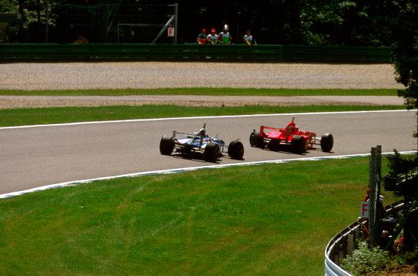 Monza, Italy.5-7 September 1997.Eddie Irvine (Ferrari F310B) closely followed by Heinz-Harald Frentzen (Williams FW19 Renault) through Parabolica.Ref-97 ITA 13.World Copyright - LAT Photographic