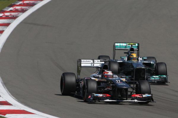 Nico Hulkenberg (GER) Sauber C32 and Lewis Hamilton (GBR) Mercedes AMG F1 W04. Formula One World Championship, Rd9, German Grand Prix, Race Day, Nurburgring, Germany, Sunday 7 July 2013.