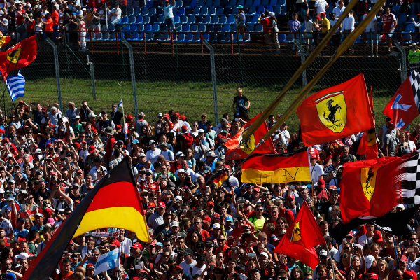 Hungaroring, Budapest, Hungary. Sunday 26 July 2015. Fans celebrate after the race. World Copyright: Alastair Staley/LAT Photographic ref: Digital Image _79P0984