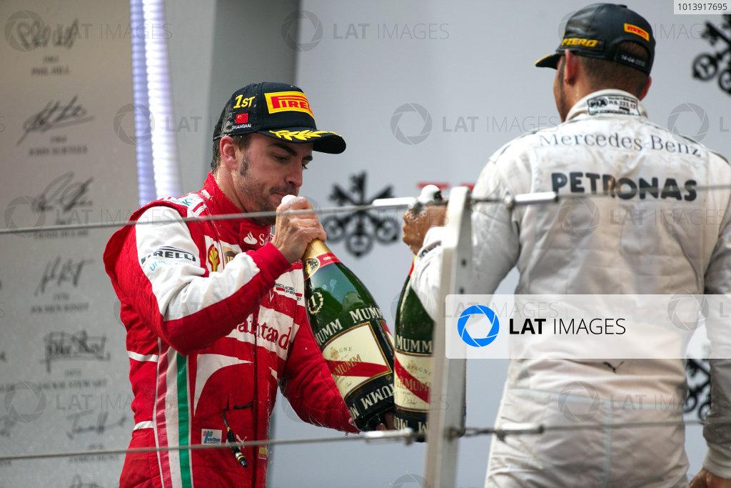 Shanghai International Circuit, Shanghai, China Sunday 14th April 2013 Fernando Alonso, Ferrari, 1st position, and Lewis Hamilton, Mercedes AMG, 3rd position, celebrate on the podium with Champagne. World Copyright: Andy Hone/LAT Photographic ref: Digital Image HONZ7958