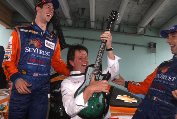 27-29 March, 2012, Homestead, Florida USA Wayne Taylor holds his victory guitar while drivers Ricky Taylor, left, and Maxx Angelelli look on. (c)2012, R.D. Ethan LAT Photo USA