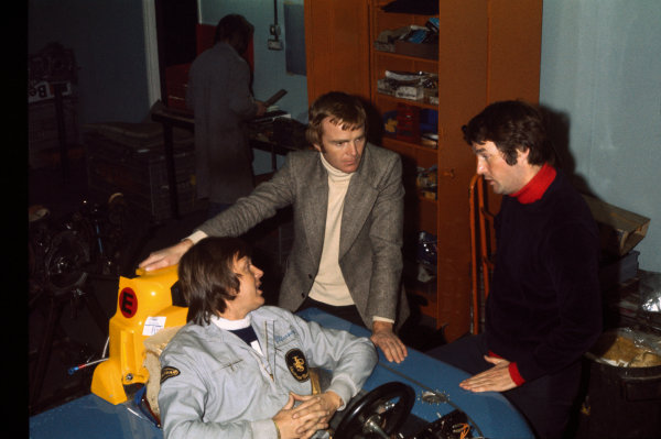 Bicester, England.Ronnie Peterson has a seat fitting at March Engineering in the March 761 with Max Mosley and designer Robin Herd, portrait. World Copyright: LAT Photographic.Ref: Colour Transparency.