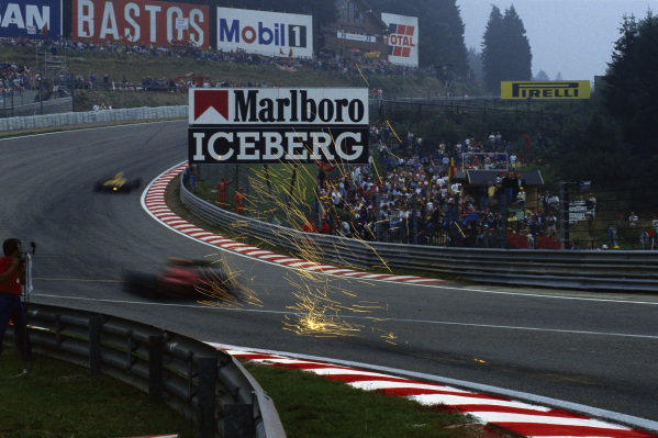 Sparks from a Ferrari at Eau Rouge.