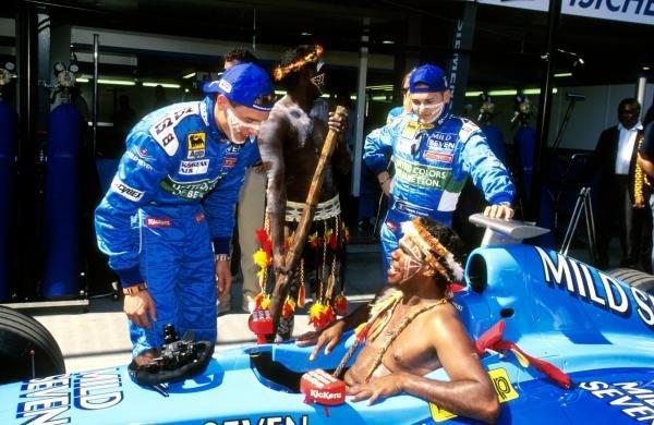 An Aborigine tries the Benetton for size Australian GP, Melbourne 7 March  1999